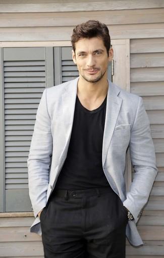 David Gandy wearing Grey Blazer, Black Crew-neck T-shirt, Black Dress Pants, Grey Gingham Pocket Square
