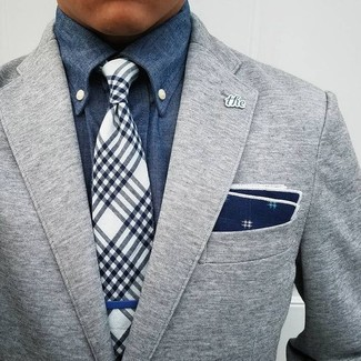 How to wear: grey wool blazer, blue denim shirt, navy and white plaid tie, navy and white print pocket square