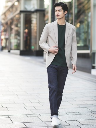 How to wear: grey blazer, dark green crew-neck t-shirt, navy jeans, white leather low top sneakers