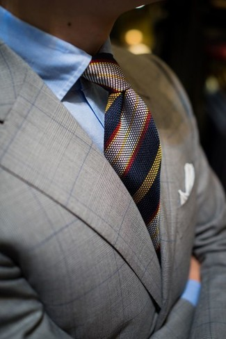 How to wear: grey plaid blazer, light blue dress shirt, navy vertical striped tie, white pocket square