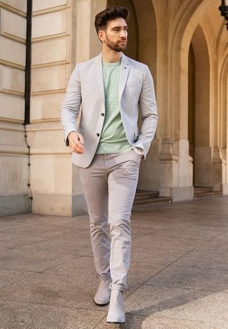 How to Wear a Grey Blazer For Men: So as you can see, looking casually neat doesn't require that much effort. Wear a grey blazer with beige chinos and be sure you'll look awesome. Serve a little mix-and-match magic by finishing off with beige suede chelsea boots.