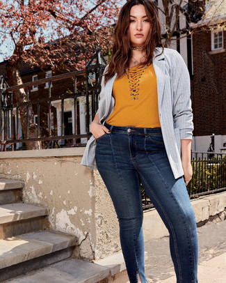 How to wear: grey vertical striped blazer, mustard v-neck t-shirt, navy skinny jeans, gold choker