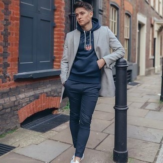 Grey Blazer with Navy Pants Outfits For Men: For an ensemble that's super straightforward but can be dressed up or down in a great deal of different ways, choose a grey blazer and navy pants. To give your overall outfit a dressier finish, why not add a pair of white canvas low top sneakers to the equation?