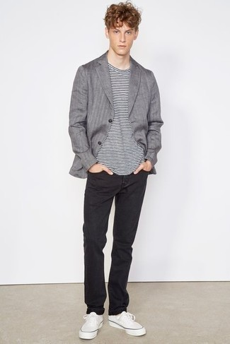Grey Vertical Striped Blazer Outfits For Men: A grey vertical striped blazer and black jeans paired together are a great match. And if you need to instantly tone down your ensemble with one single piece, complement this look with a pair of white canvas low top sneakers.