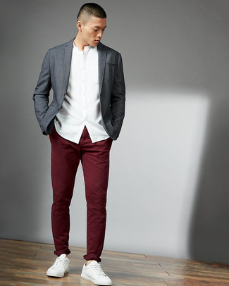Consider wearing a grey blazer and burgundy chinos for a seriously stylish look. Rock a pair of white leather low top sneakers to make the look current. Entirely appropriate for hot weather, you can wear a variation of this look all summer long.