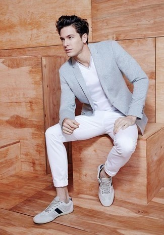 Grey Blazer Outfits For Men: This combination of a grey blazer and white chinos is definitely jaw-dropping, but it's extremely easy to wear too. Add a pair of white and black canvas low top sneakers to your outfit to keep the look fresh.