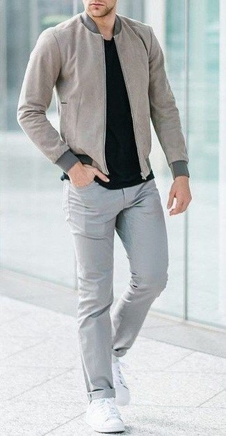 Grey Bomber Jacket Outfits For Men: Tone down on the formality in this functional combo of a grey bomber jacket and grey jeans. Let your outfit coordination chops truly shine by completing this getup with white canvas low top sneakers.