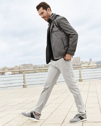 How to wear: grey bomber jacket, black turtleneck, grey chinos, grey canvas low top sneakers