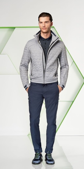 How to wear: grey quilted bomber jacket, charcoal polo, navy chinos, navy athletic shoes