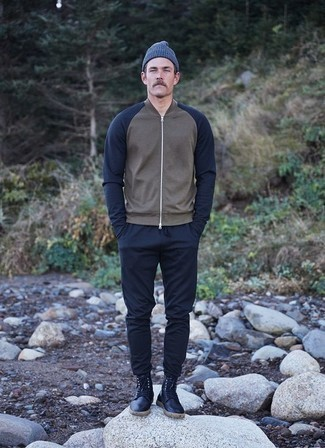Navy Leather Casual Boots Outfits For Men: This casual combo of a grey bomber jacket and navy chinos will attract attention wherever you go. Go ahead and complete your getup with navy leather casual boots for a dash of class.