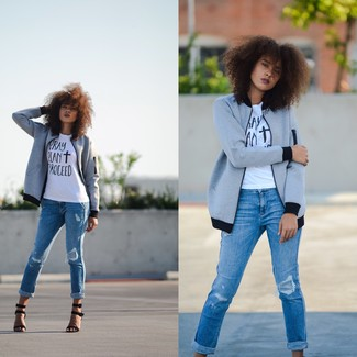 Pair a grey jacket with blue destroyed jeans for a refined yet off-duty ensemble. Black suede heeled sandals will add a touch of polish to an otherwise low-key look.