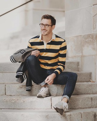 How to wear: grey bomber jacket, yellow horizontal striped polo neck sweater, black jeans, grey suede athletic shoes
