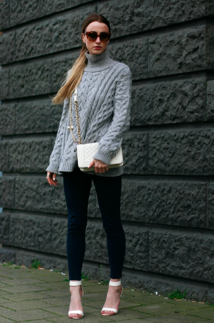 56e5c7b8269a5 How to wear: grey cable sweater, navy leggings, white heeled sandals, white