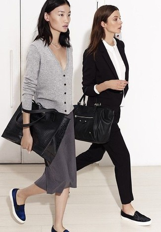 How to wear: grey cardigan, charcoal pencil skirt, navy slip-on sneakers, black leather tote bag