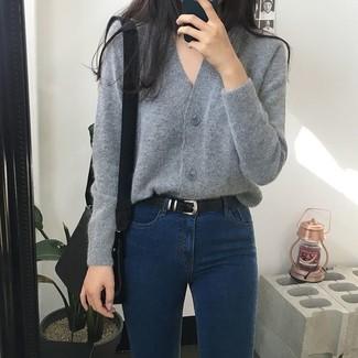 How to wear: grey cardigan, navy skinny jeans, black leather crossbody bag, black belt