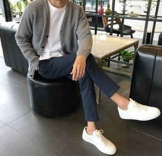 How to Wear White Low Top Sneakers For Men: This combo of a grey knit cardigan and navy chinos looks amazing and immediately makes you look cool. Complete your getup with white low top sneakers to bring a dash of stylish casualness to this look.