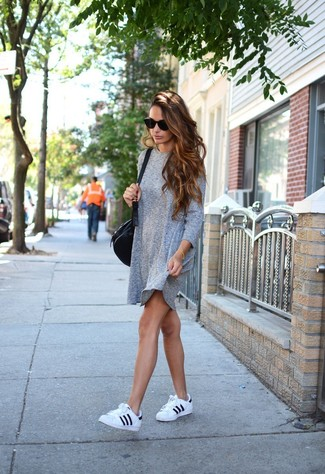 Black Leather Crossbody Bag Outfits: If the situation allows a relaxed casual outfit, you can easily go for a grey casual dress and a black leather crossbody bag. Black and white leather low top sneakers are guaranteed to breathe an air of refinement into this ensemble.