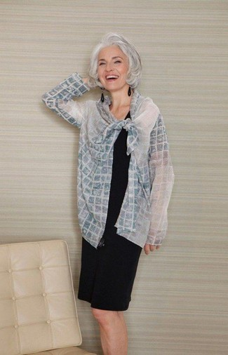 Try teaming a grey check jacket with a black shift dress to feel confidently and look fashionably.