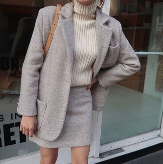 How to wear: grey coat, beige knit turtleneck, grey wool mini skirt, tan leather crossbody bag