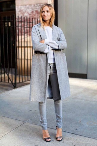 Consider teaming a grey coat with grey skinny jeans to create a chic, glamorous look. For the maximum chicness choose a pair of black suede heeled sandals.