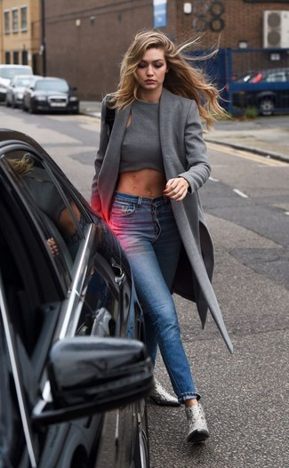 A nicely put together combination of a grey coat and blue skinny jeans will set you apart effortlessly. A pair of silver leather booties will seamlessly integrate within a variety of outfits.