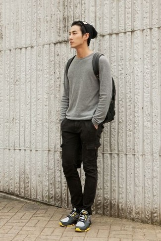 How to wear: grey crew-neck sweater, black cargo pants, grey athletic shoes, black leather backpack