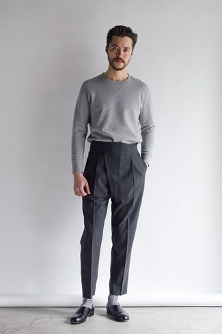 How to Wear Loafers For Men: When it comes to timeless dapper style, this combo of a grey crew-neck sweater and black dress pants never disappoints. Introduce a pair of loafers to the equation and the whole look will come together perfectly.