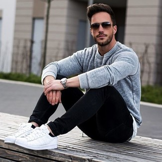 How To Wear Black Jeans With White Low Top Sneakers For Men: A grey crew-neck sweater and black jeans are among the fundamental elements in any modern gentleman's great casual collection. For maximum style, add white low top sneakers to the mix.