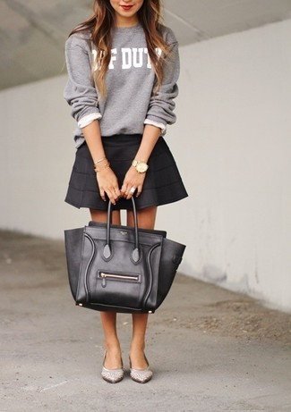 Opt for comfort in a grey print crew-neck sweater and a black skater skirt. With shoes, opt for a pair of ballet flats. Loving how this ensemble brings you into fall mode in no time.