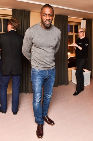 Idris Elba wearing Grey Crew-neck Sweater, Blue Jeans, Dark Brown Leather Brogues
