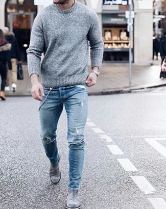 Silver Chelsea Boots Outfits For Men: A grey crew-neck sweater and blue ripped skinny jeans are a nice combination to rock a version of at the weekend. Why not add silver chelsea boots to the mix for an extra dose of refinement?