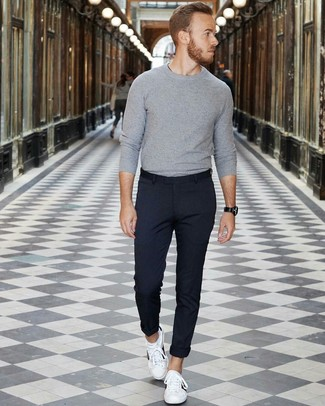 How to Wear a Grey Crew-neck Sweater For Men: Try teaming a grey crew-neck sweater with navy chinos to achieve a daily outfit that's full of style and personality. Feel somewhat uninspired with this getup? Let white leather low top sneakers switch things up.