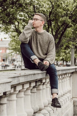 How to Wear a Grey Crew-neck Sweater For Men: For a cool and casual getup, make a grey crew-neck sweater and navy jeans your outfit choice — these pieces fit well together. Complement this look with black athletic shoes to infuse a touch of stylish nonchalance into your getup.