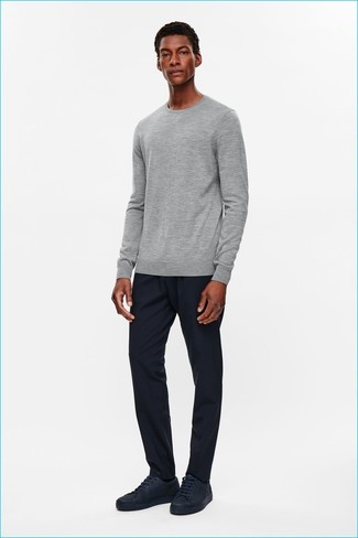 How to wear: grey crew-neck sweater, navy sweatpants, navy leather low top sneakers