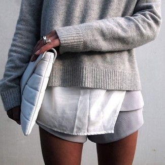 How to Wear Grey Shorts For Women: If it's comfort and practicality that you're searching for in an ensemble, wear a grey crew-neck sweater and grey shorts.
