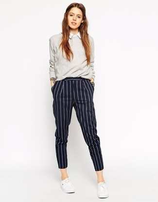 How to wear: grey crew-neck sweater, white dress shirt, navy vertical striped dress pants, white low top sneakers