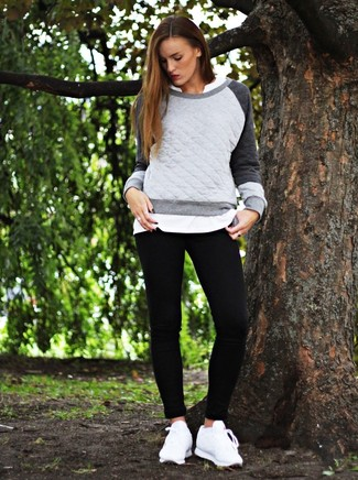 Wear a grey quilted crew-neck pullover with black leggings for a casual-cool vibe. A pair of white leather low top sneakers will seamlessly integrate within a variety of outfits.