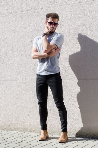 How to Wear Tan Leather Chelsea Boots For Men: This laid-back combo of a grey crew-neck t-shirt and black chinos is extremely easy to pull together without a second thought, helping you look dapper and prepared for anything without spending a ton of time rummaging through your closet. Not sure how to finish off your outfit? Wear a pair of tan leather chelsea boots to dial it up a notch.