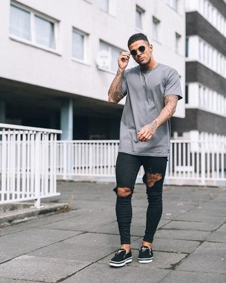 Pair a grey crew-neck t-shirt with black ripped skinny jeans for a relaxed take on day-to-day wear. Channel your inner Ryan Gosling and throw in a pair of slip-on sneakers to class up your ensemble. Seeing as it's roasting hot outside, this look is great and entirely season-appropriate.