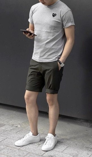 How to Wear Dark Green Shorts For Men: If you feel more confident in functional clothes, you'll appreciate this off-duty pairing of a grey crew-neck t-shirt and dark green shorts. All you need is a pair of white leather low top sneakers to round off your outfit.
