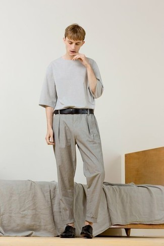 Grey Crew-neck T-shirt Outfits For Men: Indisputable proof that a grey crew-neck t-shirt and grey chinos look awesome when paired up in a laid-back menswear style. A pair of black leather derby shoes will give an elegant twist to this outfit.