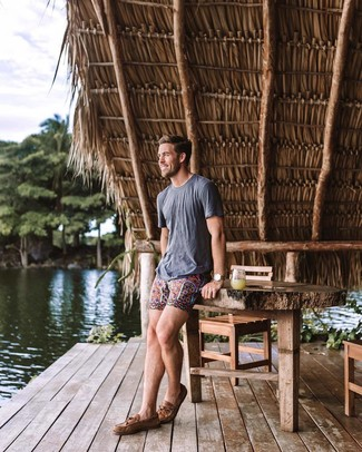 How to wear: grey crew-neck t-shirt, multi colored print shorts, brown leather boat shoes, brown leather watch