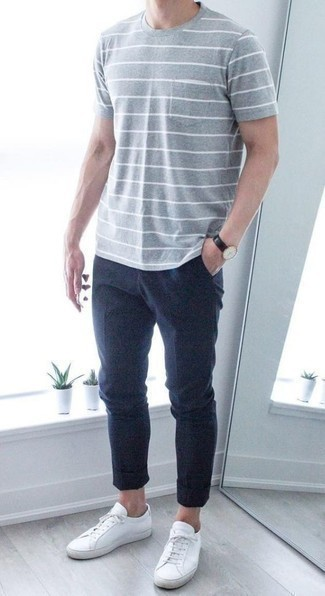 Men's Looks & Outfits: What To Wear In 2020: A grey horizontal striped crew-neck t-shirt and navy chinos are a savvy pairing to keep in your off-duty collection. A pair of white canvas low top sneakers is a tested footwear option here that's full of character.