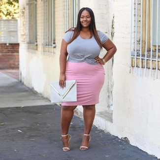 Choose a grey crew-neck t-shirt and a pink pencil skirt to demonstrate you've got serious styling prowess. Play down the casualness of your look with white leather heeled sandals. You can't go wrong with this one on a warm afternoon.