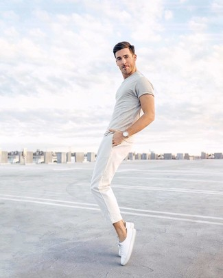 How to wear: grey crew-neck t-shirt, white chinos, white canvas low top sneakers, tan leather watch