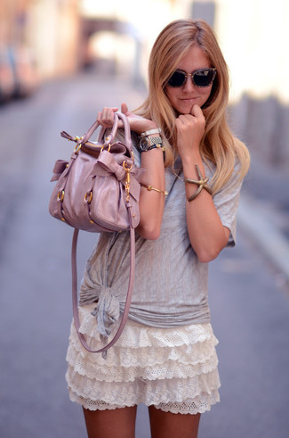 How to wear: grey crew-neck t-shirt, white ruffle lace mini skirt, pink leather tote bag