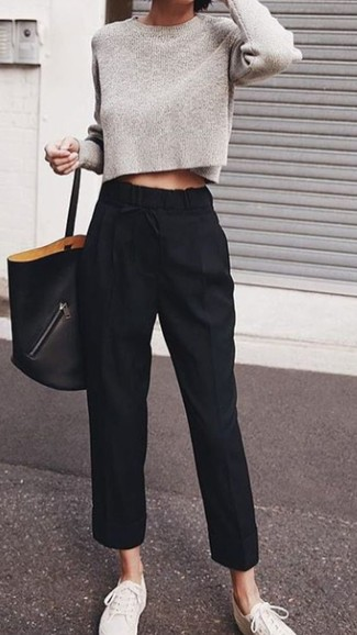 How to Wear White Canvas Low Top Sneakers For Women: For relaxed dressing with a twist, you can always rely on a grey cropped sweater and black tapered pants. White canvas low top sneakers will add a carefree feel to your ensemble.