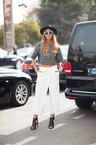If you're facing a fashion situation where comfort is prized, team a grey tweed cropped sweater with white wide leg pants. A pair of black leather heeled sandals will add more polish to your overall look. A practical example of transeasonal fashion, this look is a staple this spring.