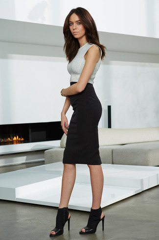 A silver cropped top and a black pencil skirt is a smart combination worth integrating into your wardrobe. Take a classic approach with the footwear and throw in a pair of black elastic heeled sandals.