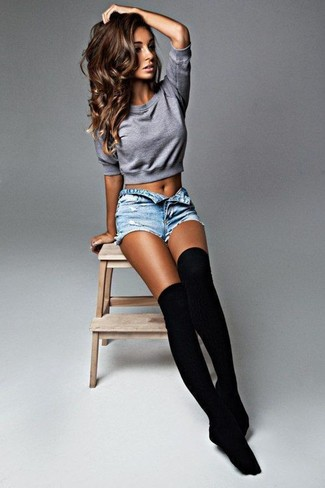 Wear a metallic cropped top with light blue denim shorts to create a chic, glamorous look.